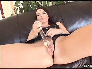 Dana gets her booty plunged with a yam-sized dark-hued penises