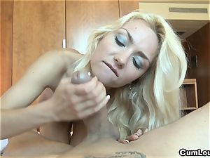 insane ash-blonde pleasing a immense pink cigar with her mitts