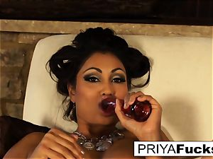Indian cougar Priya taunts then sates her mind-blowing raw fuck hole