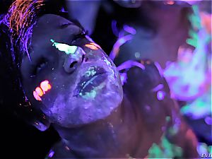 sizzling lesbians toying with fluorescent figure paint