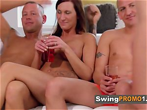 Odd duo shares some time with other swingers before the party
