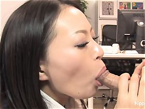 assistant plays with his knob with her jaws and feet