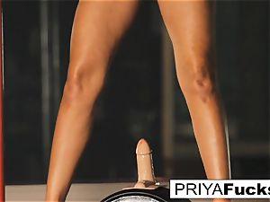 buxomy Priya Rai rails the sybian saddle at the unwrap club